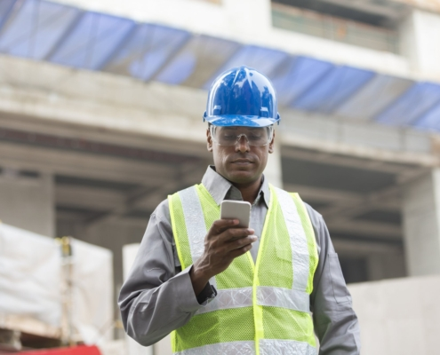 construction worker looking at phone