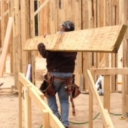 contractor carrying lumber